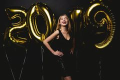 New Year. Woman With Balloons Celebrating At Party. Portrait Of Beautiful Smiling Girl In Shiny Dress Throwing Confetti royalty free stock photo