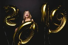 New Year. Woman With Balloons Celebrating At Party. Portrait Of Beautiful Smiling Girl In Shiny Dress Throwing Confetti stock image