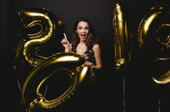 New Year. Woman With Balloons Celebrating At Party. Portrait Of Beautiful Smiling Girl In Shiny Dress Throwing Confetti royalty free stock photography