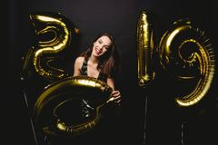 New Year. Woman With Balloons Celebrating At Party. Portrait Of Beautiful Smiling Girl In Shiny Dress Throwing Confetti stock photography