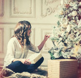 New Year Woman Portrait near Christmas Tree with gift boxes Stock Photography
