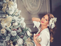 New Year Woman Portrait near Christmas Tree with gift boxes Royalty Free Stock Photo