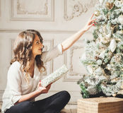 New Year Woman Portrait near Christmas Tree with gift boxes Stock Images