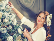 New Year Woman Portrait near Christmas Tree with gift boxes. Royalty Free Stock Images