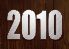 New year wood. Dark wood background with new year date in silver metal Stock Photo