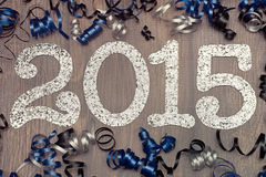 New year 2015 on wood floor with confetti and champagne Royalty Free Stock Photos