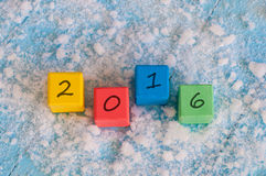 New 2016 Year wood number on color wooden cubes Royalty Free Stock Photos
