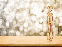 2018 new year wood number 3d rendering on wood table with spar. Kling gold bokeh wall,leave space for display or montage of product Royalty Free Stock Image