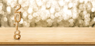 2018 new year wood number on wood table with sparkling gold boke. H wall,panoramic banner for display or montage of product Royalty Free Stock Image