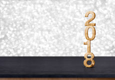 2018 new year wood number on wood table with sparkling silver bo. Keh wall,panoramic banner for display or montage of product Royalty Free Stock Photography