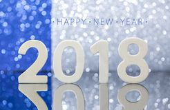 New year 2018 wood numbers reflexion on glass table Royalty Free Stock Photos