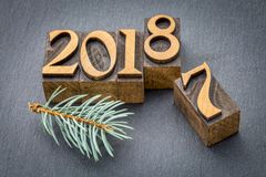 New year 2018 in wood type. New year 2018 replacing the old year 2017 - letterpress wood type printing blocks on a slate stone stock image