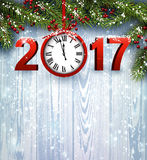 2017 New Year wooden background. 2017 Year wooden background with clock and fir branches. Vector illustration Stock Photography