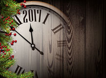 2017 New Year wooden background. 2017 Year wooden background with clock and fir branches. Vector illustration Royalty Free Stock Photo