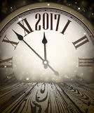 2017 New Year wooden background. 2017 Year background with clock and wooden texture. Vector illustration Royalty Free Stock Images