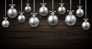 New Year background with Christmas balls. New Year wooden background with silver Christmas balls. Vector illustration Stock Image