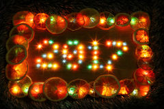 2017 new year on wooden desk table background from lights. 2017 new year on wooden desk table background. Number from colorful lights lamp bulb. Frame border Royalty Free Stock Photo