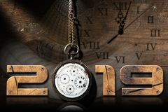 2019 New Year - Old Broken Pocket Watch. 2019 New Year - Wooden numbers with an old and broken pocket watch with chain on a wooden background royalty free illustration