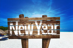 New Year wooden sign with a beach on background Stock Images