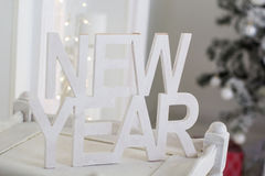 New Year wooden table over christmas background Royalty Free Stock Photography