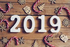 New year 2019 word and Christmas decoration on wooden table. Bus. Iness concept royalty free stock photo