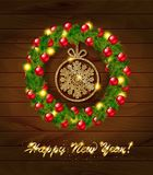 New year wreath with baubles and christmas tree. Stock Photo