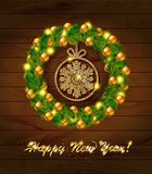 New year wreath with baubles and christmas tree. Royalty Free Stock Photography