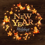 New year wreath garland poster. With lettering New year holidays in a retro style with decorations in garlands gloving on wood background Stock Image