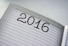 New Year 2016. Writing in his diary in 2016 about the coming year Stock Photography
