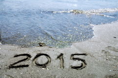New Year 2015. Written on the beach, with the sea in background royalty free stock image