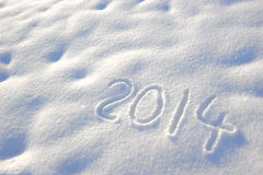 New year 2014. Written in fresh powder snow Royalty Free Stock Image