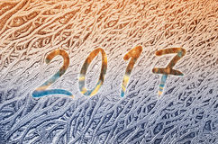 New year 2017 written on a frozen glass Stock Photos