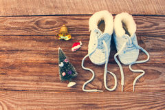 2017 new year written laces of children`s shoes, christmas decorations. On old wooden background. Toned image. Top view stock photography