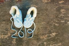 2019 new year written laces of children`s shoes on old wood stock photography
