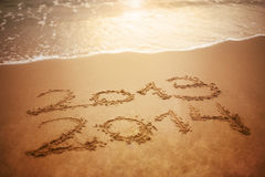 New year 2014. New Year 2013/ 2014 written on the sand Royalty Free Stock Photography