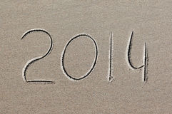 New year 2014 written in sand Stock Photos