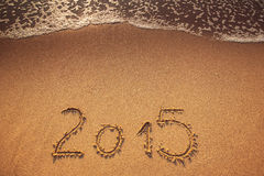 New year 2015 written in sand Royalty Free Stock Images