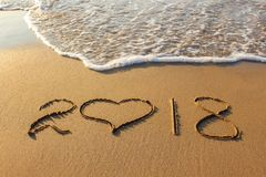 2018 new year written on sandy beach.  stock images