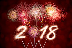 2018 new year. 2018 written with Sparkle firecracker and firework Royalty Free Stock Image