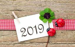 New Year 2019. New Years card  for 2019 with leafed clover and ladybugs on wooden background Stock Photography