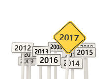 2017 New year on yellow road sign. Stock Photos