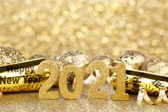Free New Years 2021 Gold Numbers And Decor With Twinkling Light Background Stock Photography - 202586492