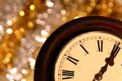 New years. Image of New years eve celebration with a clock showing few minutes before midnight Stock Images
