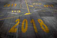 2018 new years background. Closeup 2018 figures on the surface of the airport runway texture background royalty free illustration