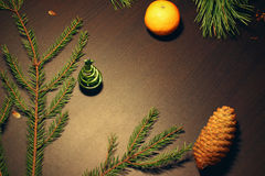 New Years background with fir-tree,. New Years background with Christmas tree, branches and mandarin Royalty Free Stock Photography