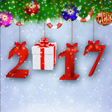 New Years background with gift. 2017 New Years background with giftbox hanging from the the fir tree. concept for greeting or postal card. vector illustration Royalty Free Stock Images