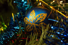 New Years ball in blue gold colour. New Year`s Eve Christmas ball bauble wintertime decoration blue. Traditional winter ornament happy holidays Merry Xmas event stock photos