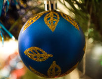 New Years ball on a branch. New Year`s Eve Christmas ball bauble wintertime decoration blue sphere hanging adornment classic. Traditional winter ornament happy stock photos