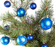 New Years balls on branches of a Christmas tree. Royalty Free Stock Photo
