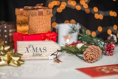 New years and christmas deco, written its xmas time on wooden de Royalty Free Stock Photography